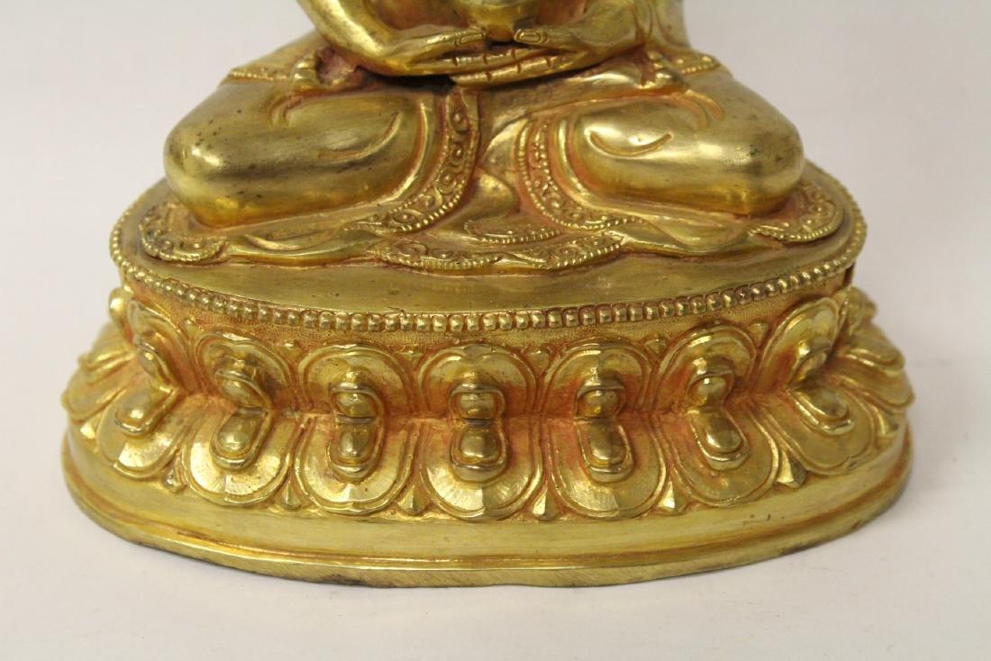 A gilt bronze sculpture of seated Buddha - 3