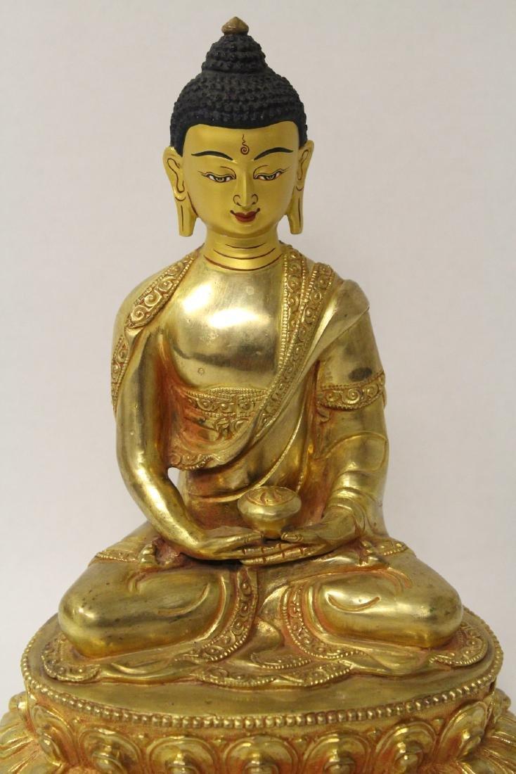 A gilt bronze sculpture of seated Buddha - 4