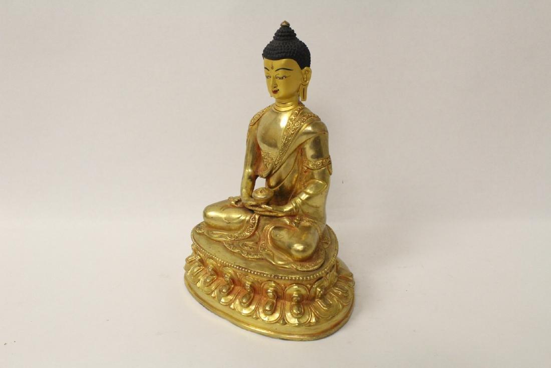 A gilt bronze sculpture of seated Buddha - 6