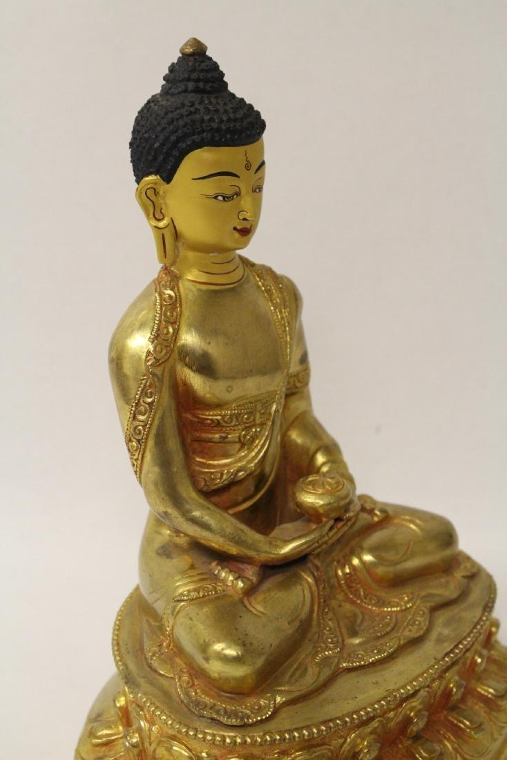 A gilt bronze sculpture of seated Buddha - 7