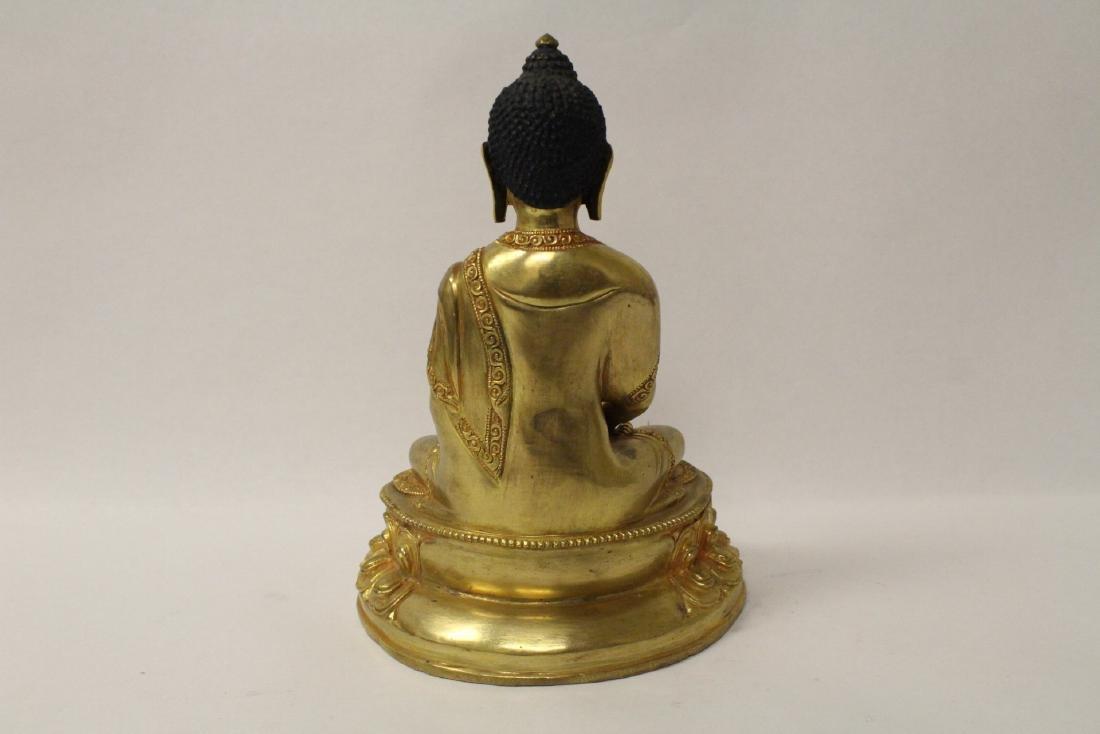 A gilt bronze sculpture of seated Buddha - 8