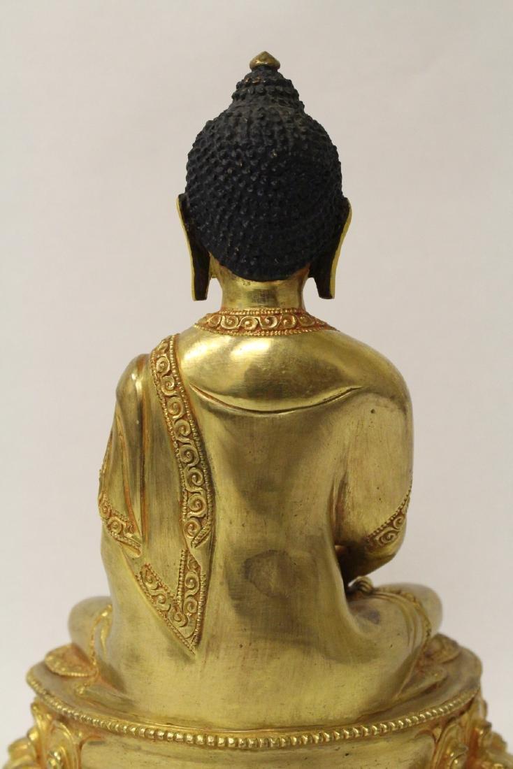 A gilt bronze sculpture of seated Buddha - 9