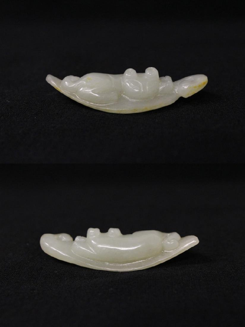 2 white jade ornaments - 2
