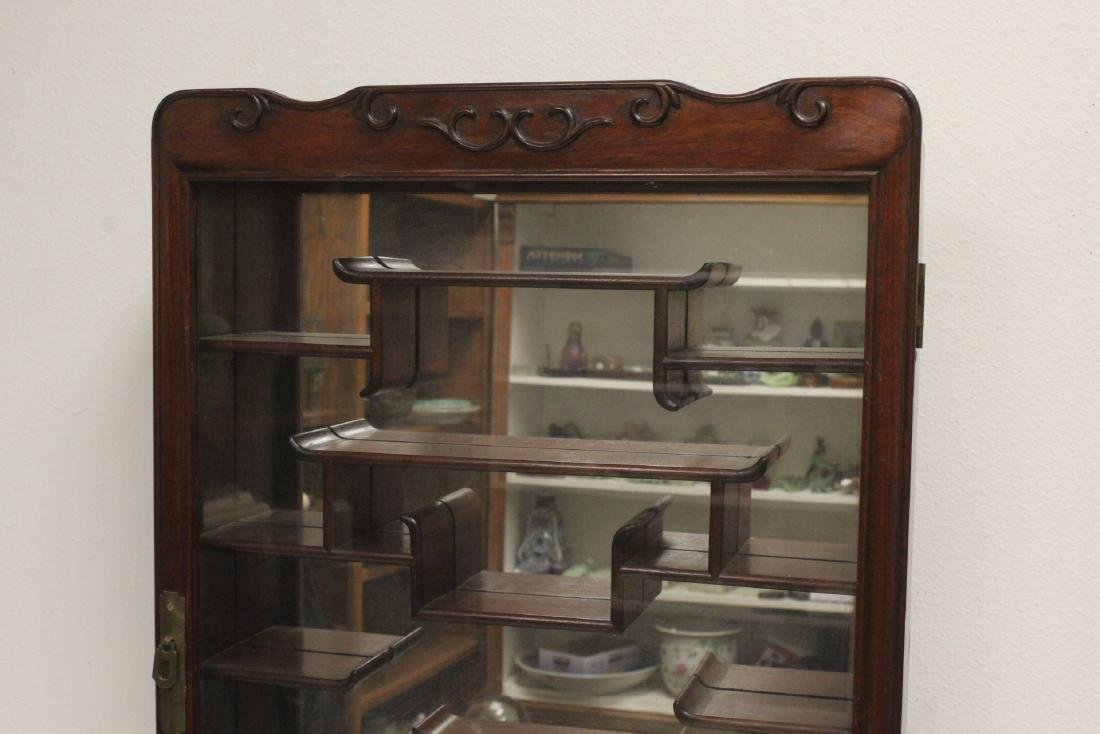A rosewood wall hanging curio cabinet - 2