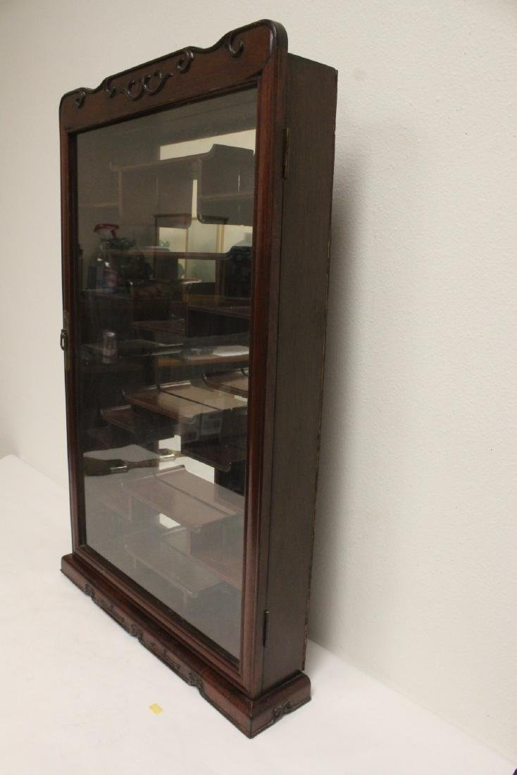 A rosewood wall hanging curio cabinet - 4
