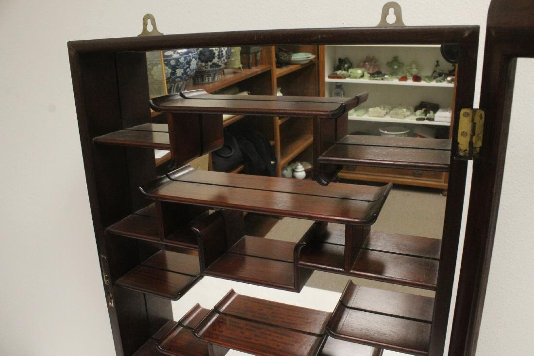 A rosewood wall hanging curio cabinet - 8