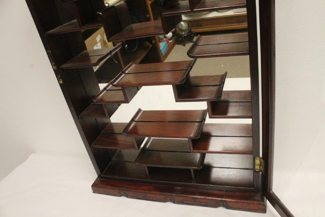 A rosewood wall hanging curio cabinet - 9