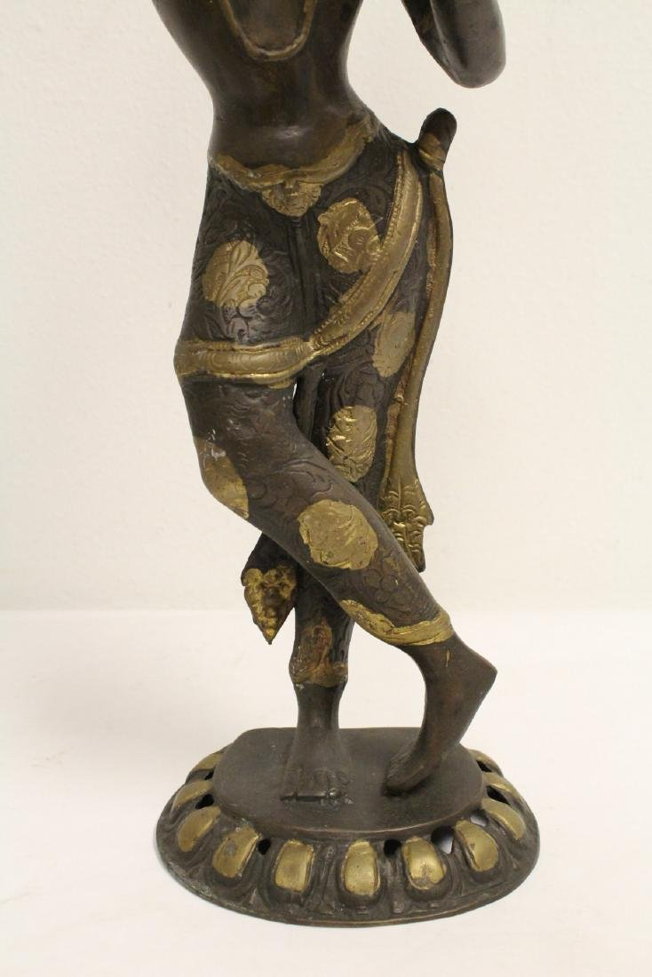 A bronze sculpture of standing Buddha - 2