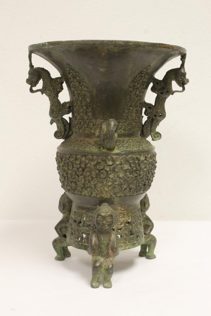 archaic style bronze jar with figural motif feet