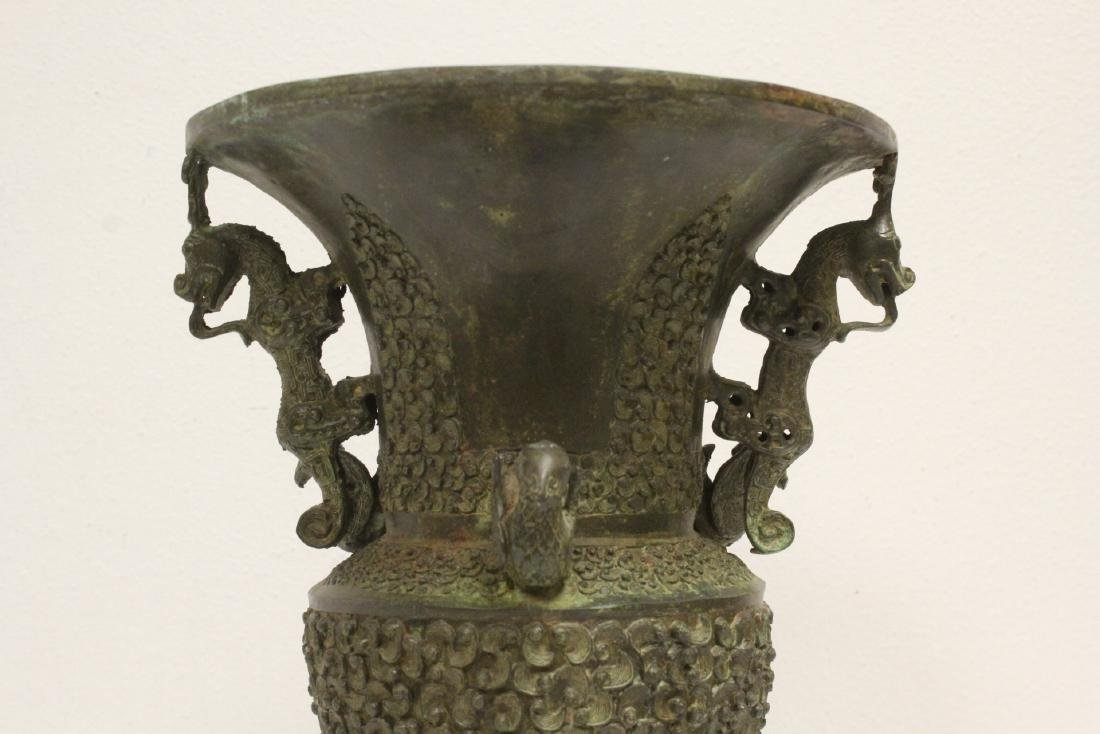 archaic style bronze jar with figural motif feet - 6
