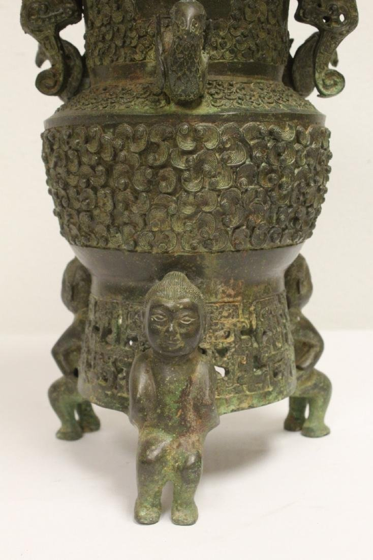 archaic style bronze jar with figural motif feet - 7