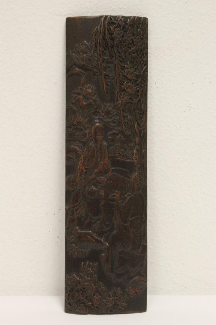 A fine bamboo carved armrest