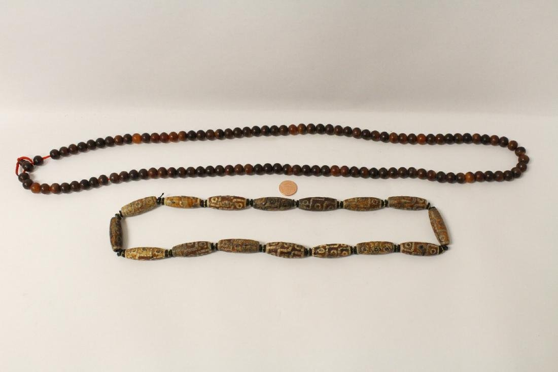 A horn bead necklace, and a dzi bead style necklace