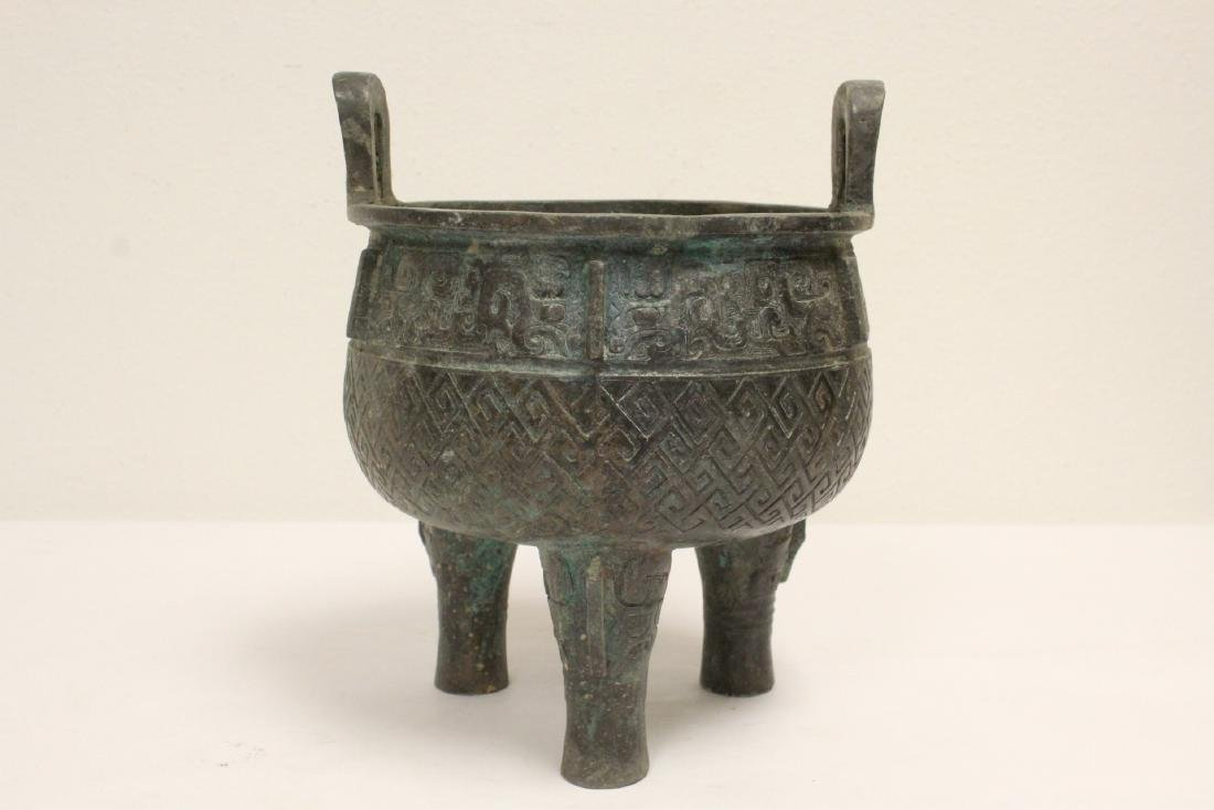 Archaic style bronze ding