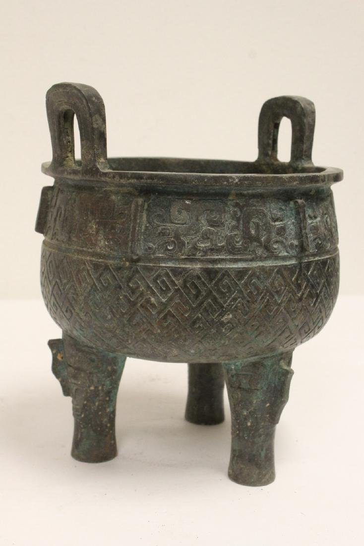 Archaic style bronze ding - 9
