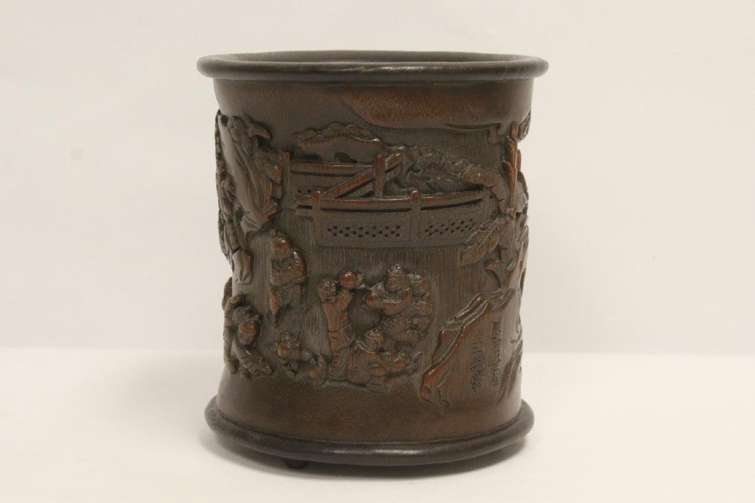 A finely carved bamboo brush holder