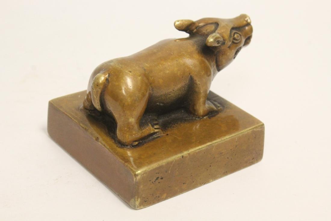 A bronze seal with buffalo finial - 10