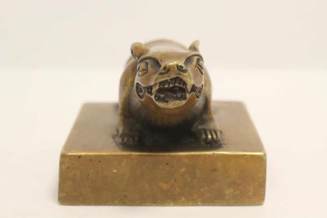A bronze seal with buffalo finial - 2