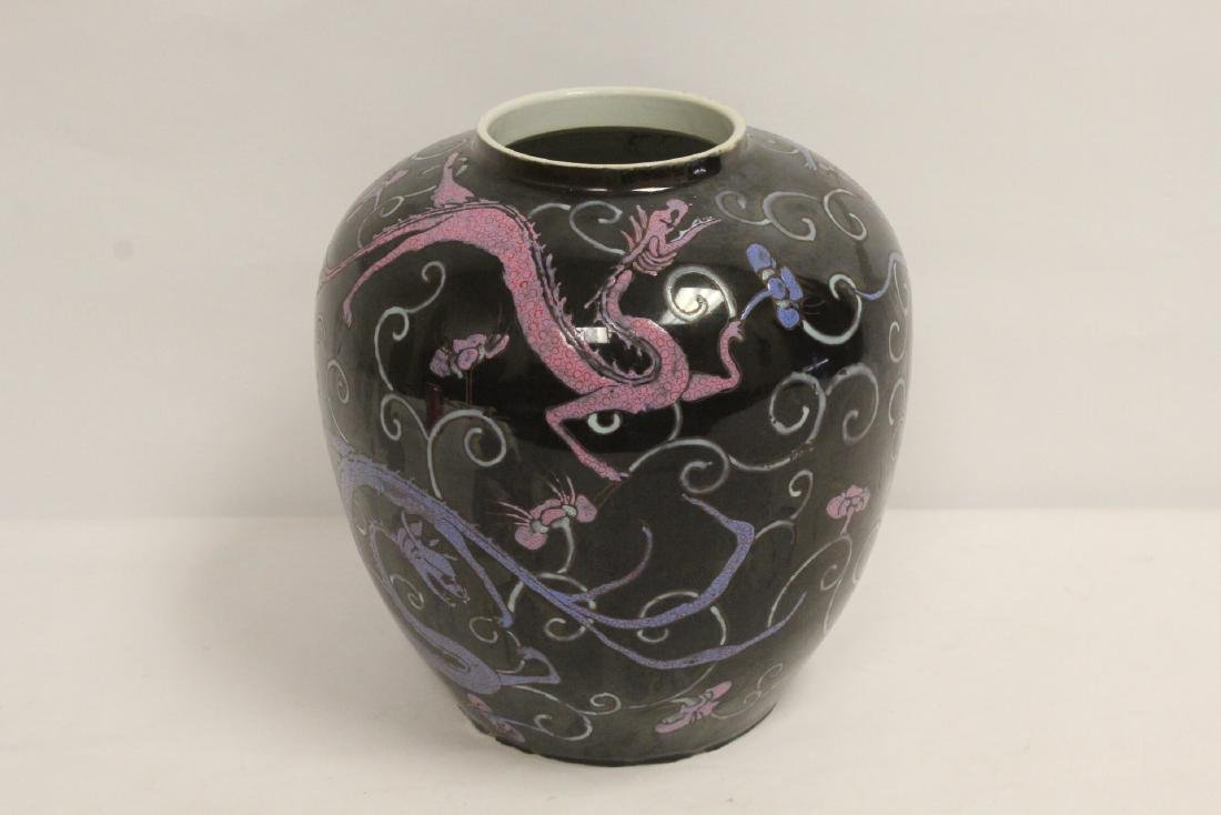 Chinese black background famille rose porcelain jar