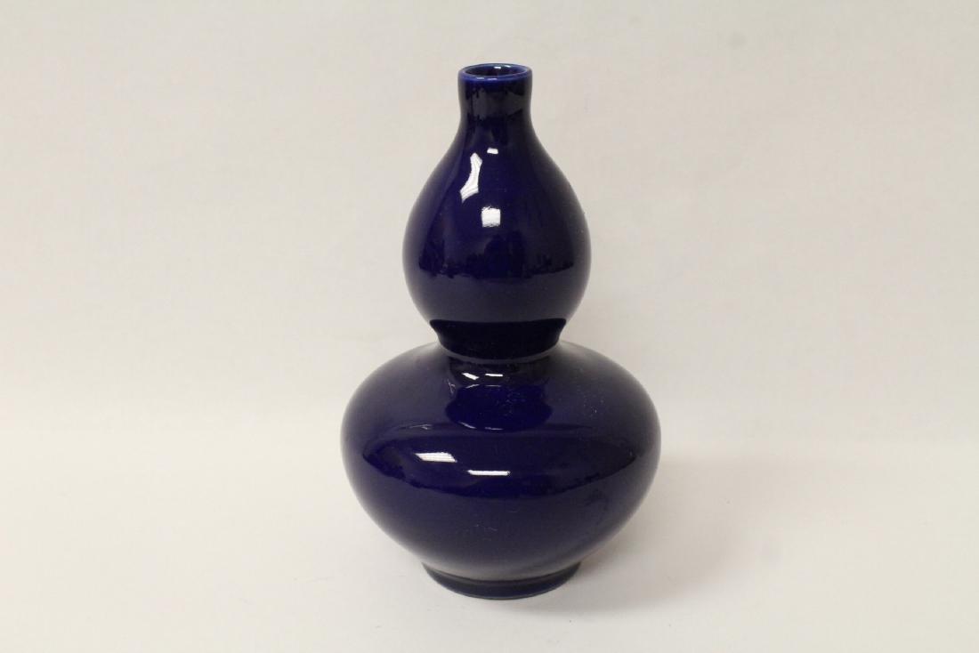 Blue glazed gourd shape vase