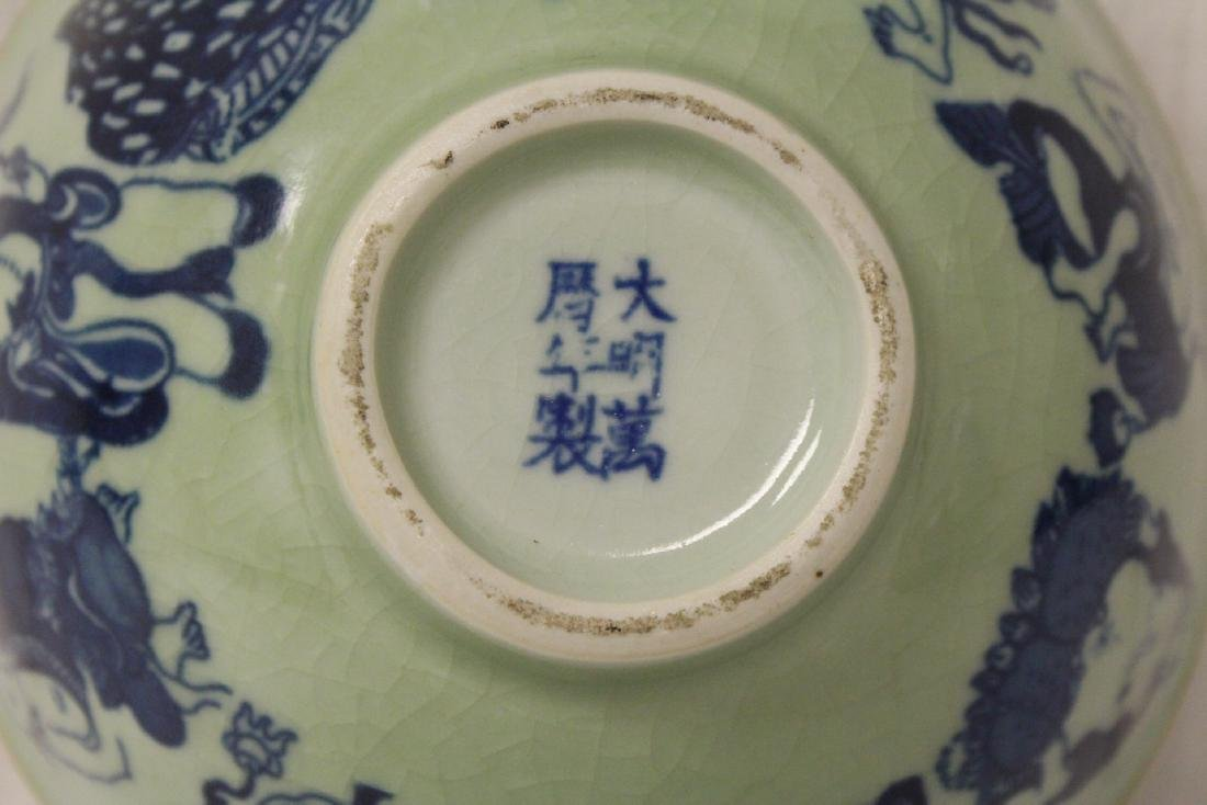 A blue and white charger and a blue and white bowl - 10