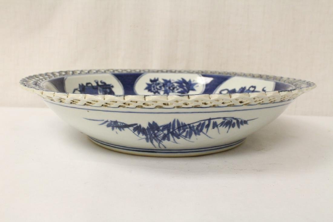 A blue and white charger and a blue and white bowl - 2