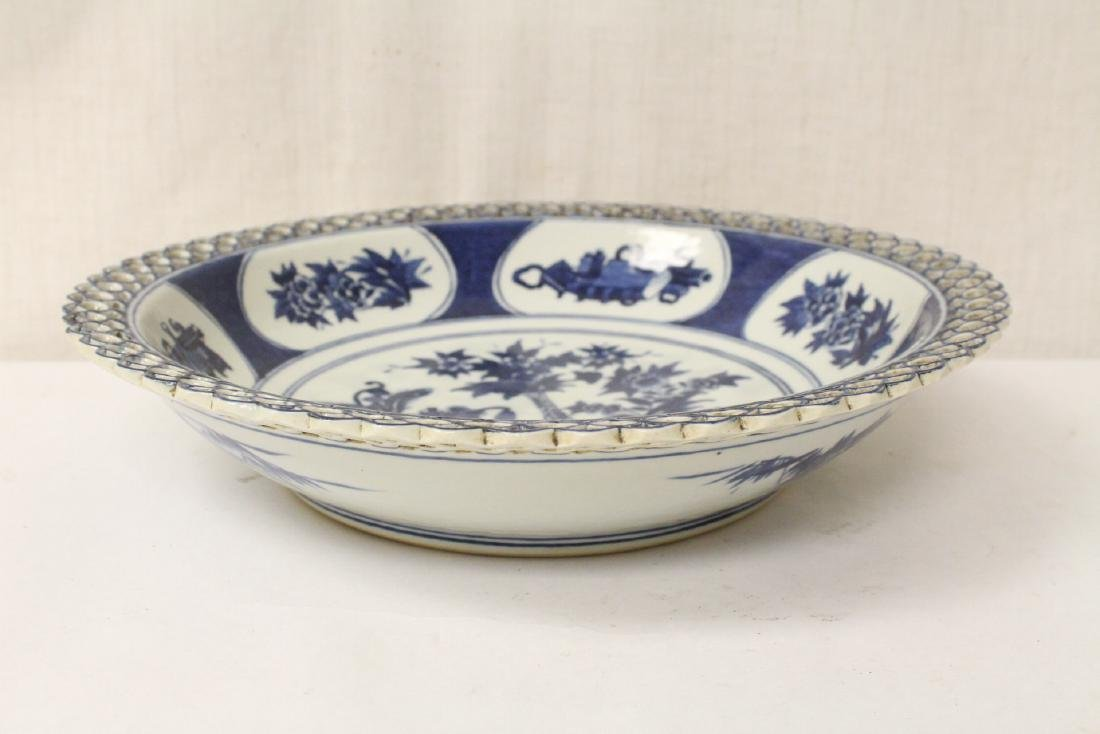 A blue and white charger and a blue and white bowl - 3