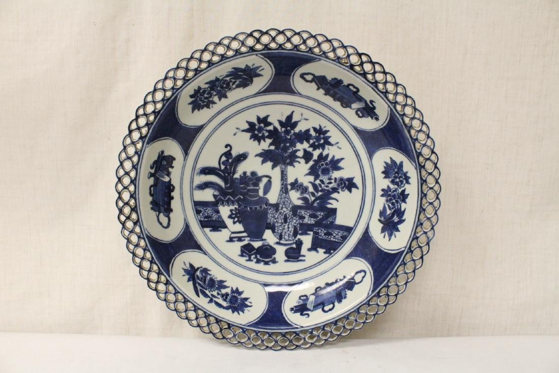 A blue and white charger and a blue and white bowl - 4