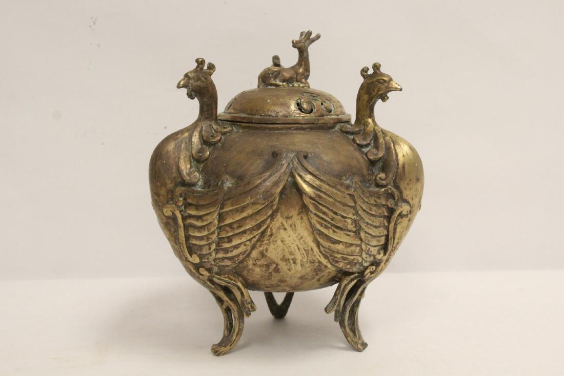 A bronze censer with phoenix motif legs