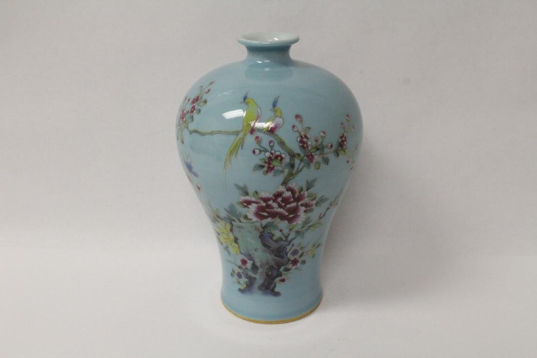Blue background famille rose porcelain vase