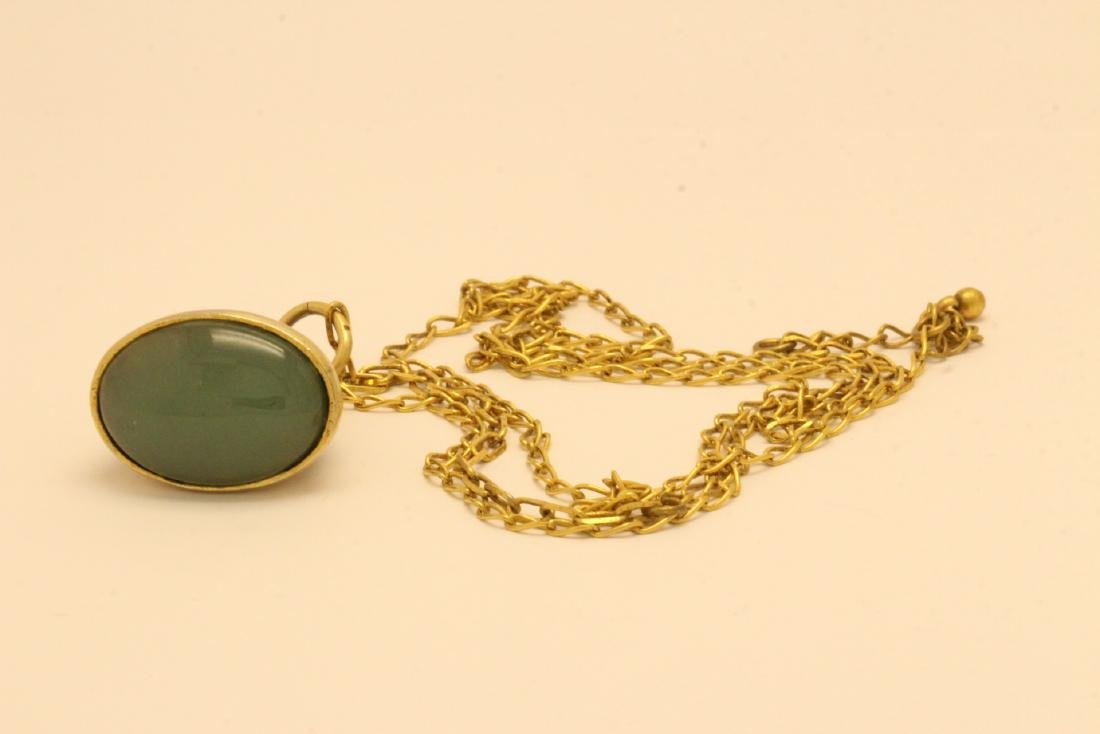 A possible watch fob w/ a large jade cabochon