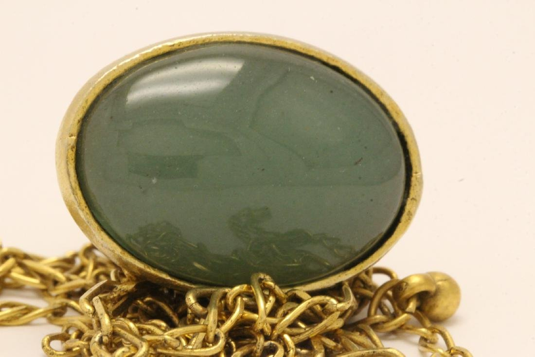 A possible watch fob w/ a large jade cabochon - 9