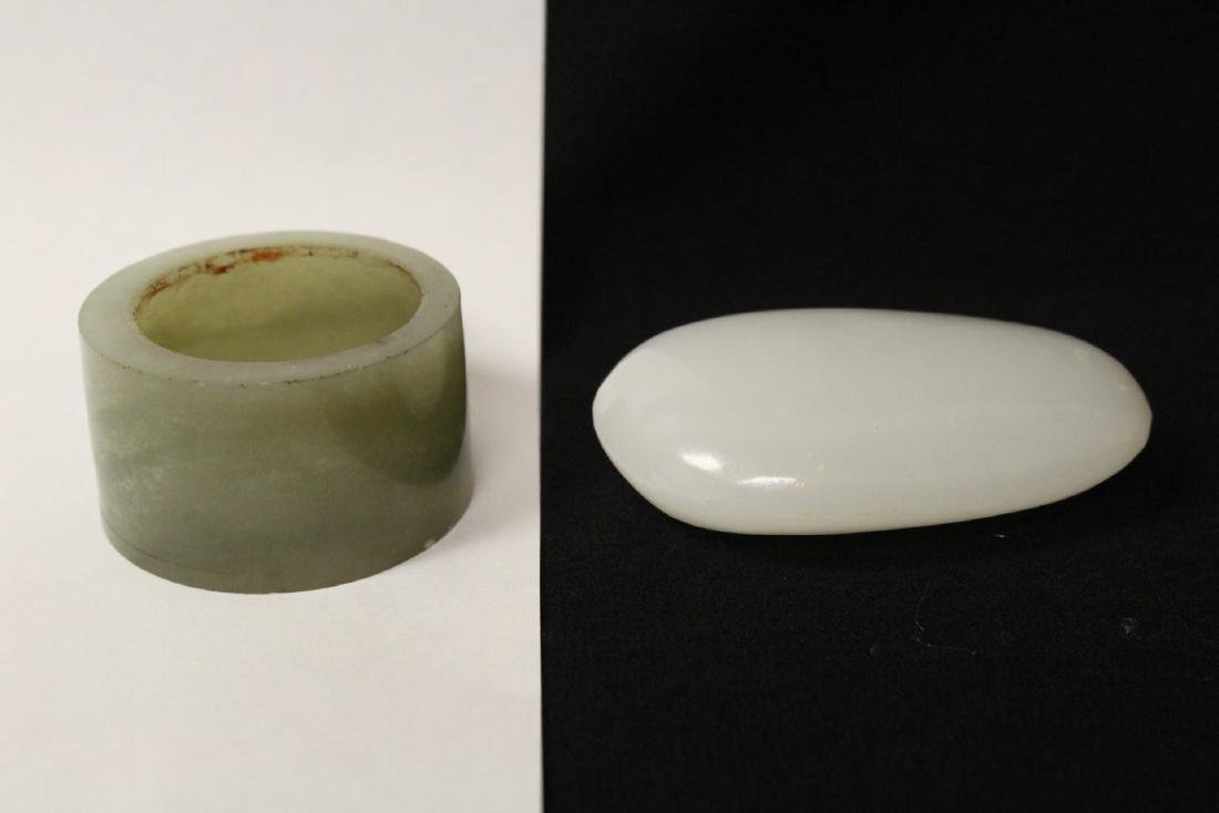 A pebble stone and a large celadon jade bangle ring