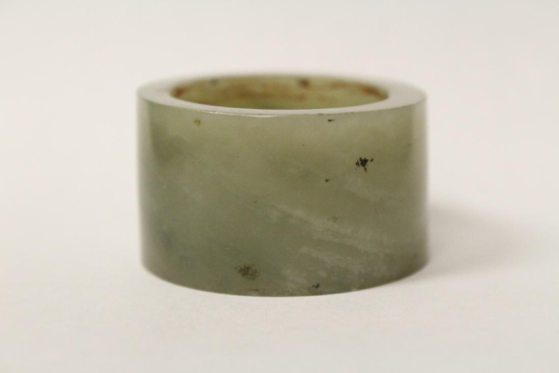A pebble stone and a large celadon jade bangle ring - 3