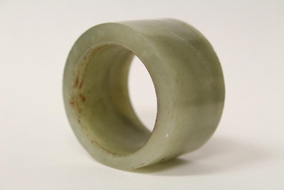 A pebble stone and a large celadon jade bangle ring - 4
