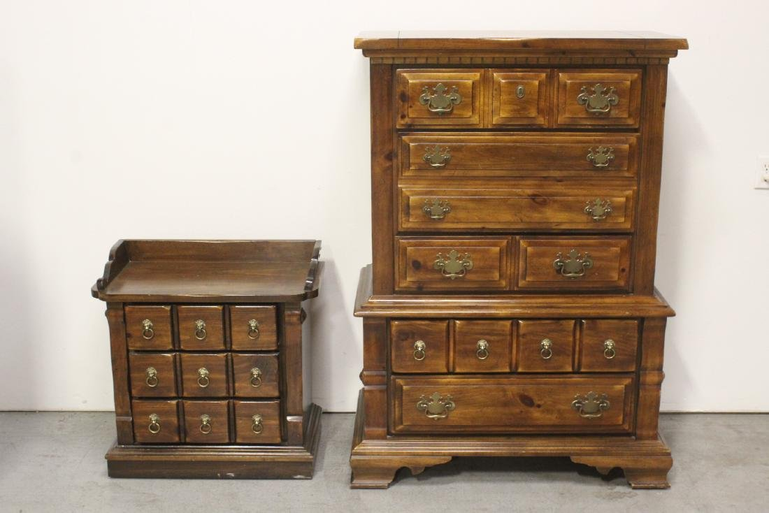 A pine chest of drawers and a pine lamp table