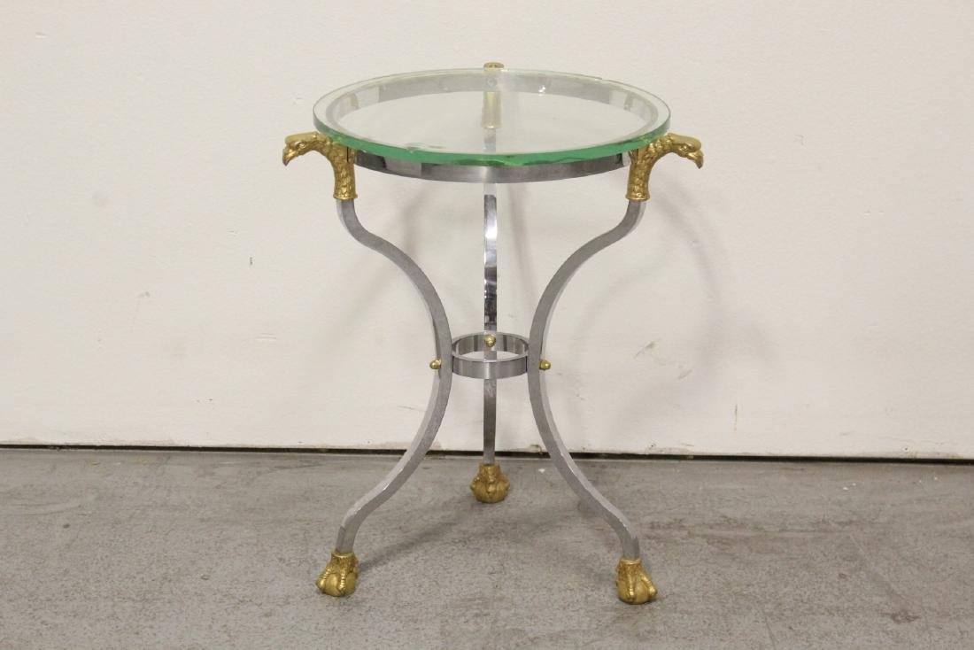 A beautiful chrome and gilt steel round side table