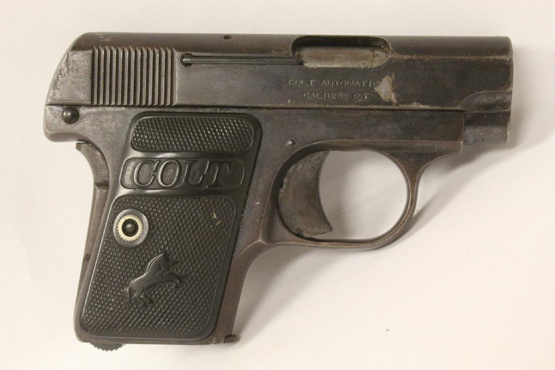 Antique 25 Colt pistol with holster