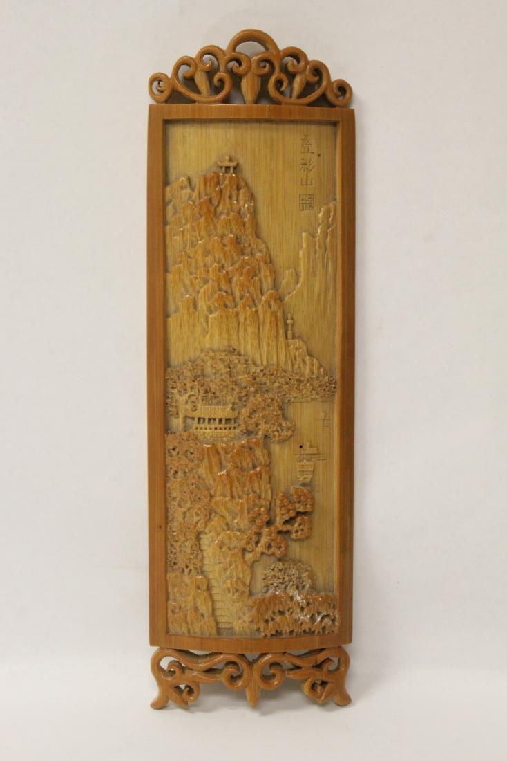 A very elaborately carved Chinese bamboo armrest