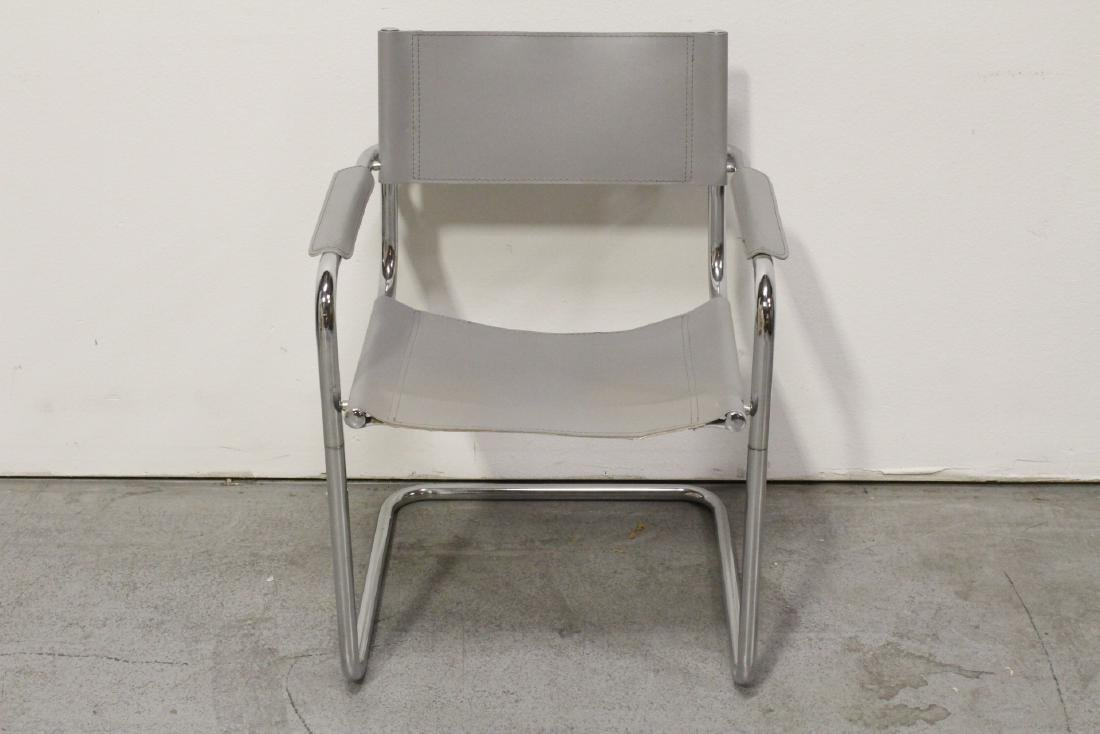 A leather & chromed stainless steel chair