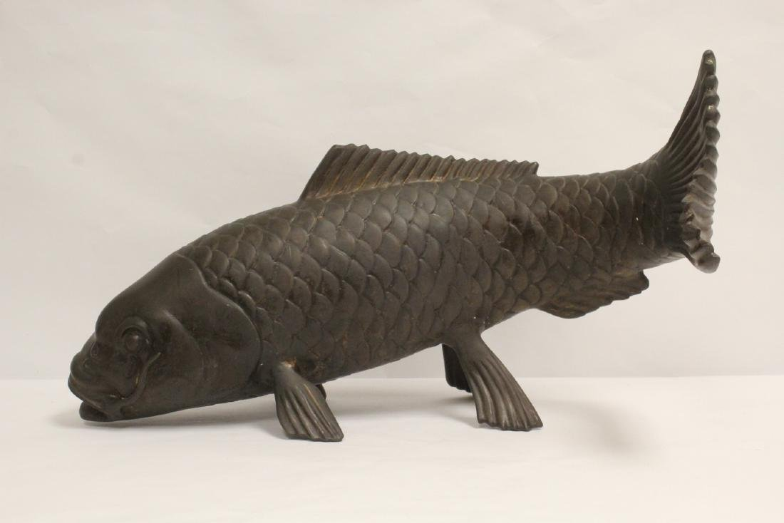 Large bronze sculpture depicting fish