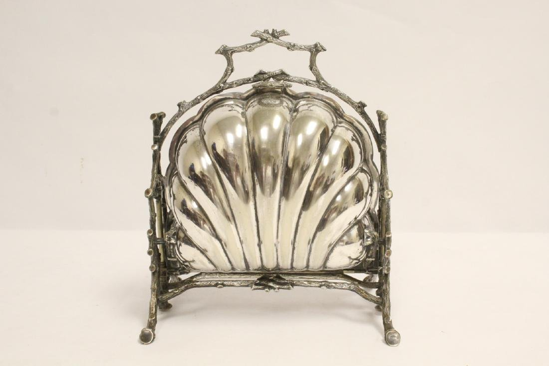 A very fancy Victorian silverplate toast warmer