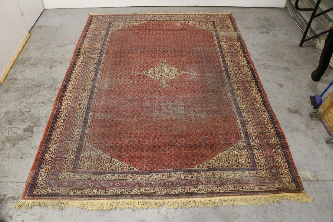 A large room size Persian rug