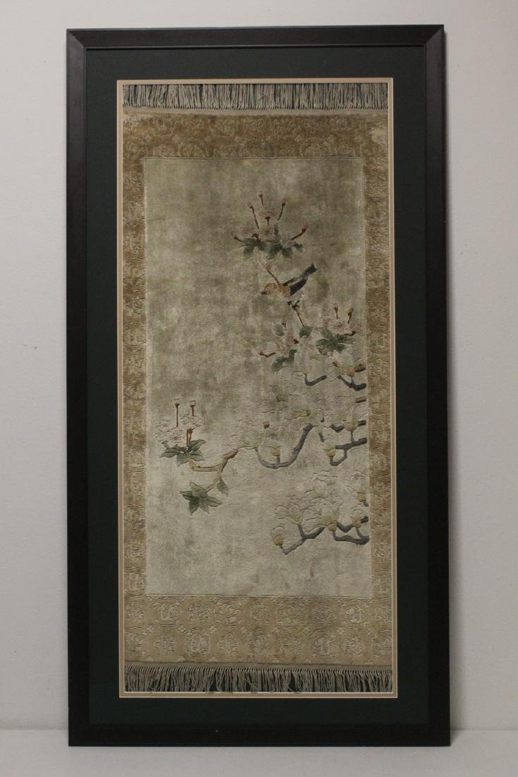 A beautiful framed silk rug