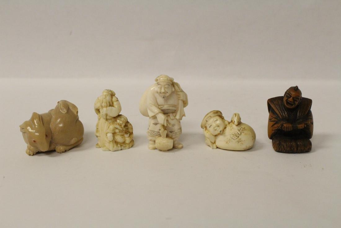 One wood and 4 bone carved Japanese netsuke