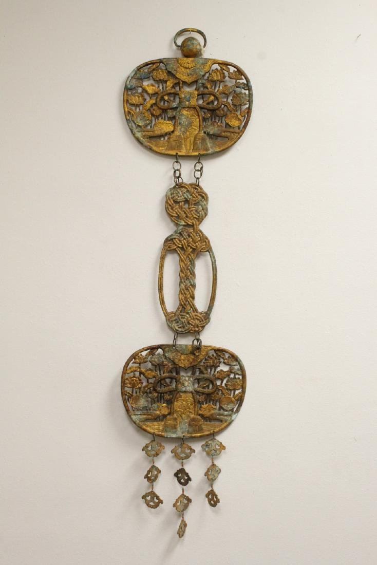 A Japanese gilt cast iron ornament