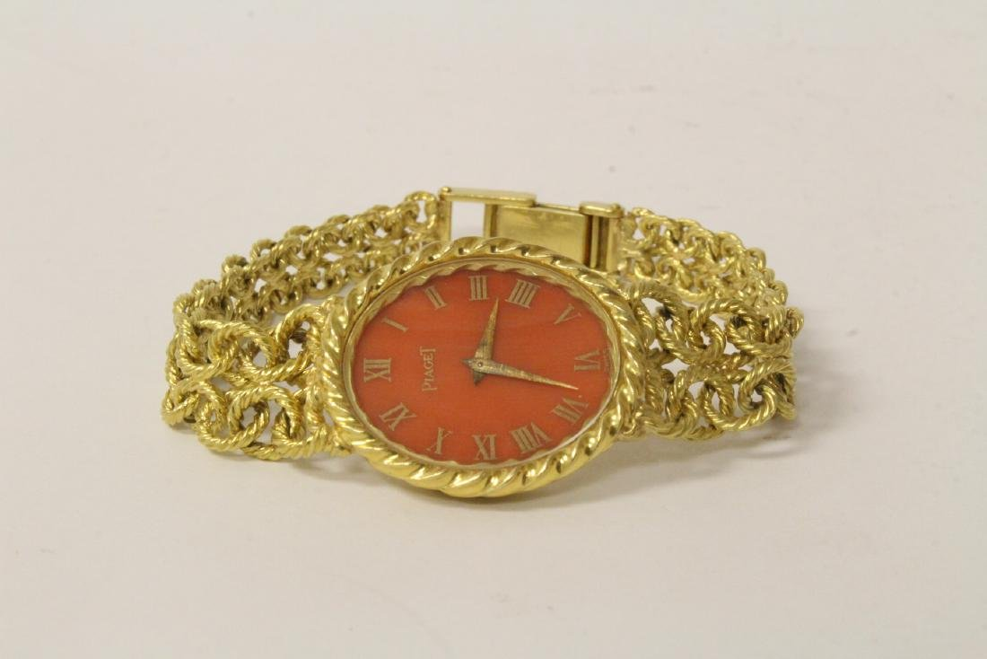 red dial 18K Piaget watch w/ 18K original bracelet