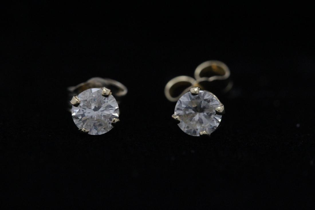 Pair 14K Y/G diamond earrings
