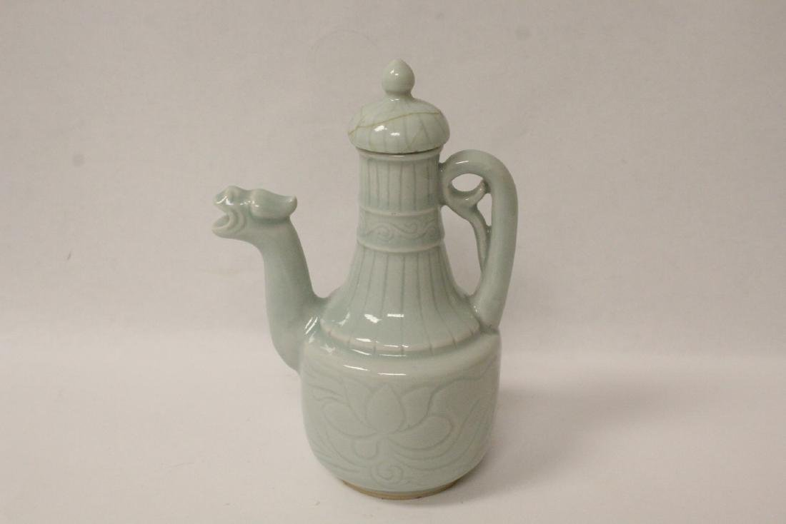 A sky blue porcelain wine server