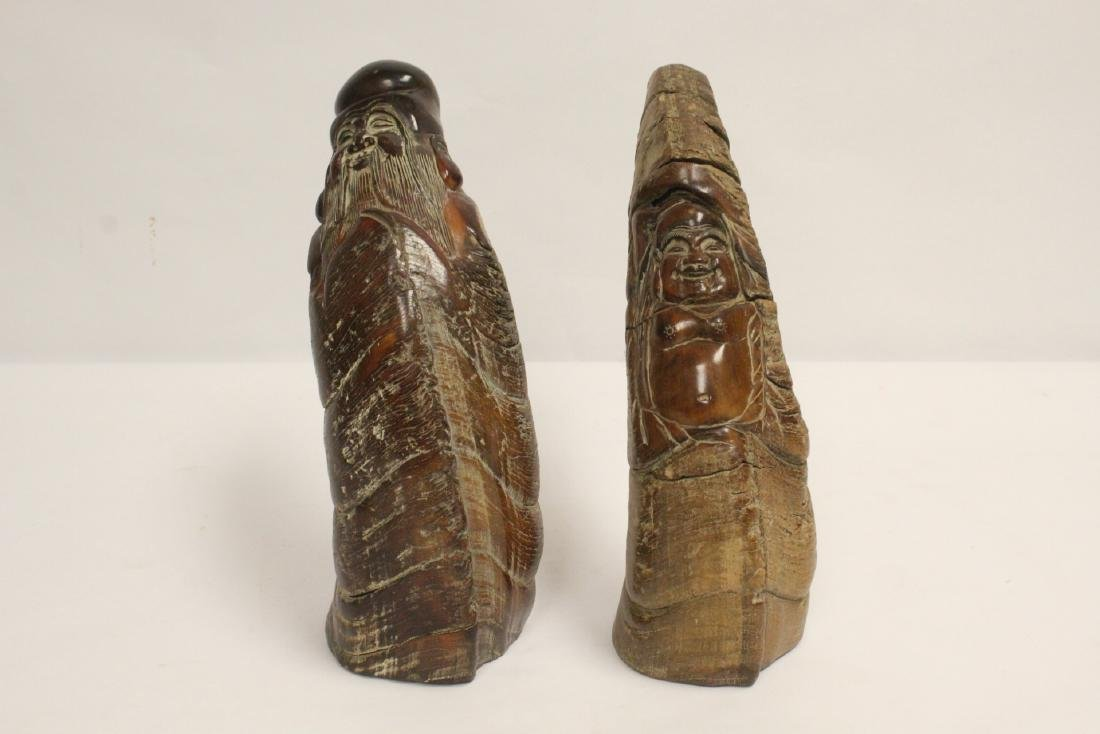 2 horn carved figures
